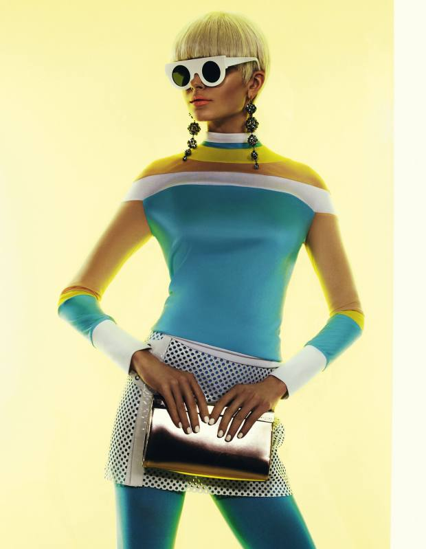 Silk jersey top, £526, by Thomas Tait. Patent-leather, cotton and wool-mix skirt, £565, by Versus. Nylon tights, $10, by We Love Colors. Leather bag, £625, by Jimmy Choo. Sunglasses with polarised lenses, $110, by Slow and Steady Wins the Race. Metal and crystal earrings, $108, by Circa Sixty Three