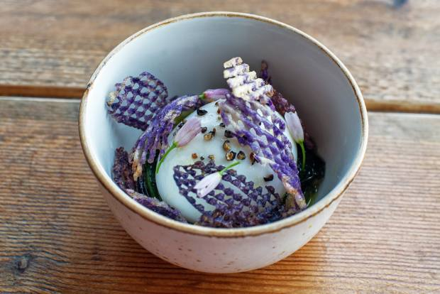Soft-boiled egg with purple potato gaufrette, wild garlic and olive-oil foam