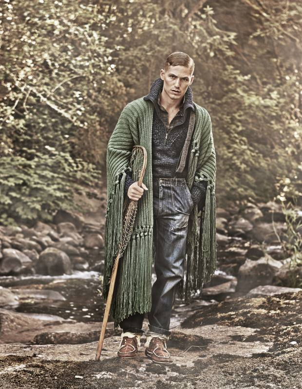 Burberry cashmere poncho, £1,995. Bottega Veneta wool/polyester jumper, £820, cotton shirt, £525, denim trousers, £340, and linen/ cotton and leather braces, £260. Jérôme Dreyfuss shearling and lambskin Cheyenne moccasins, £535