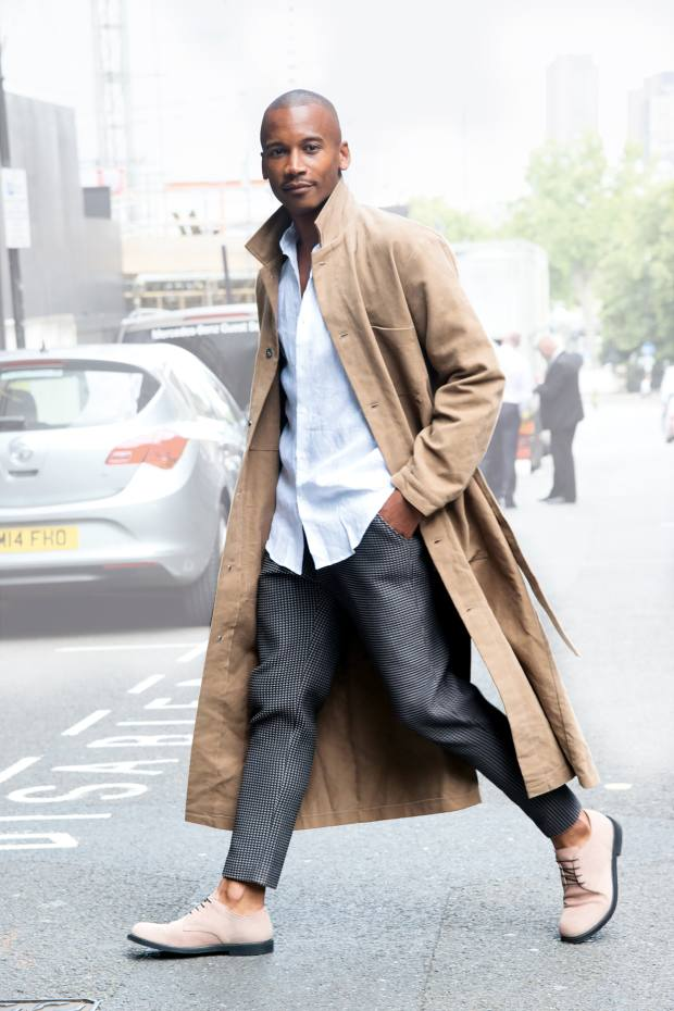 Eric Underwood wearing an Insomnia shirt, jacket and trousers and Kurt Geiger shoes at London Fashion Week Men's, in June this year