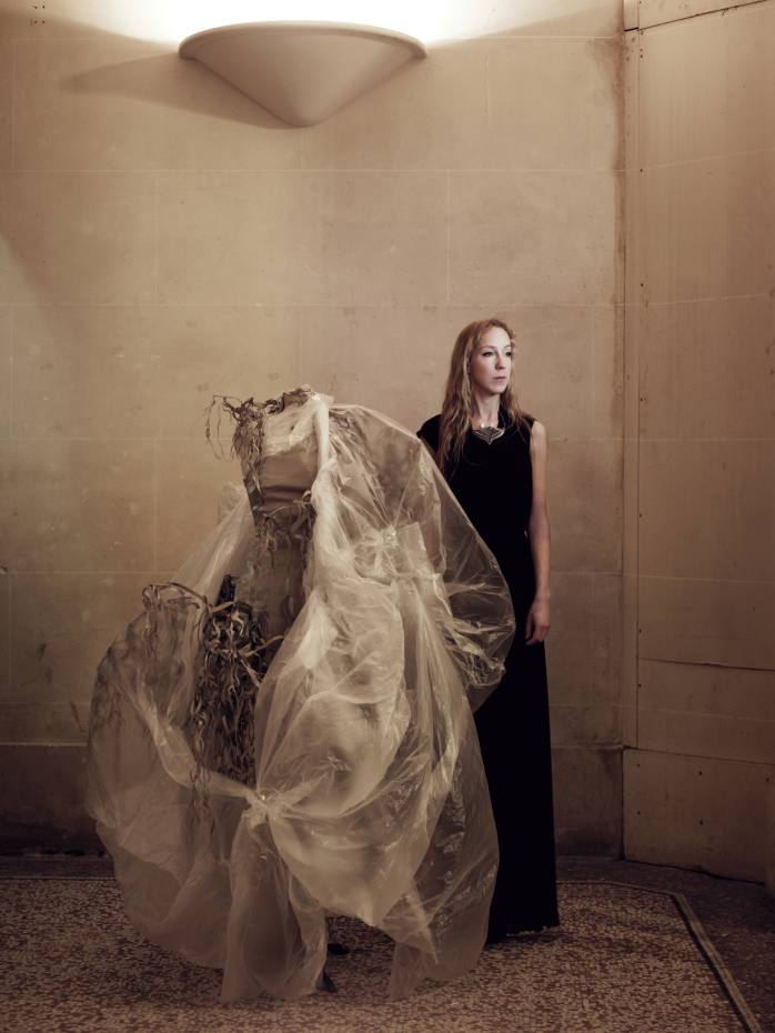 Iris van Herpen at her Amsterdam studio with a dress, price on request, from her latest collection, Syntopia