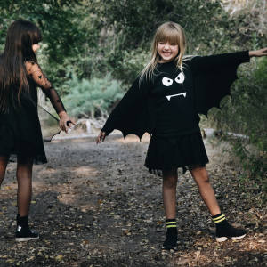 From left: dress with mesh sleeves and detachable bat wings, £106. Sweatshirt with batwing sleeves, £63