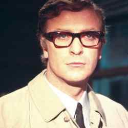 Le Corbusier wearing his trademark specs