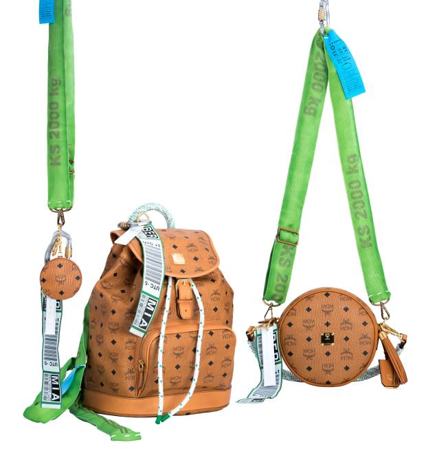 The collection includes, from left, a small coin wallet that hangs around the neck, a backpack with rope straps, and a crossbody bag