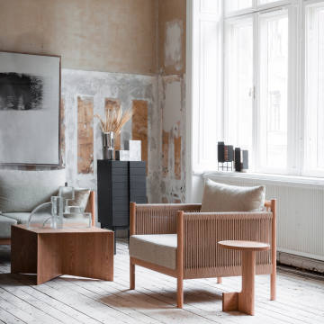 Norm Architects for AriakeCollection oak, paper-cordand fabric Braid chair,€2,246, references the linear patterns of traditional oriental tatami mats