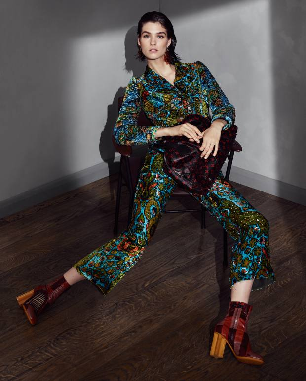 Soft furnishings Fabrics and prints from the world of interiors provide strikingly unexpected sartorial inspiration  Louis Vuitton silk-mix jacket, £4,365, viscose trousers, £3,450, eel‑leather Instinct boots, £1,120, brass ear cuffs, from £190, brass and resin Pop Chips earrings, £550, and canvas Alma Monogram bag, £1,870