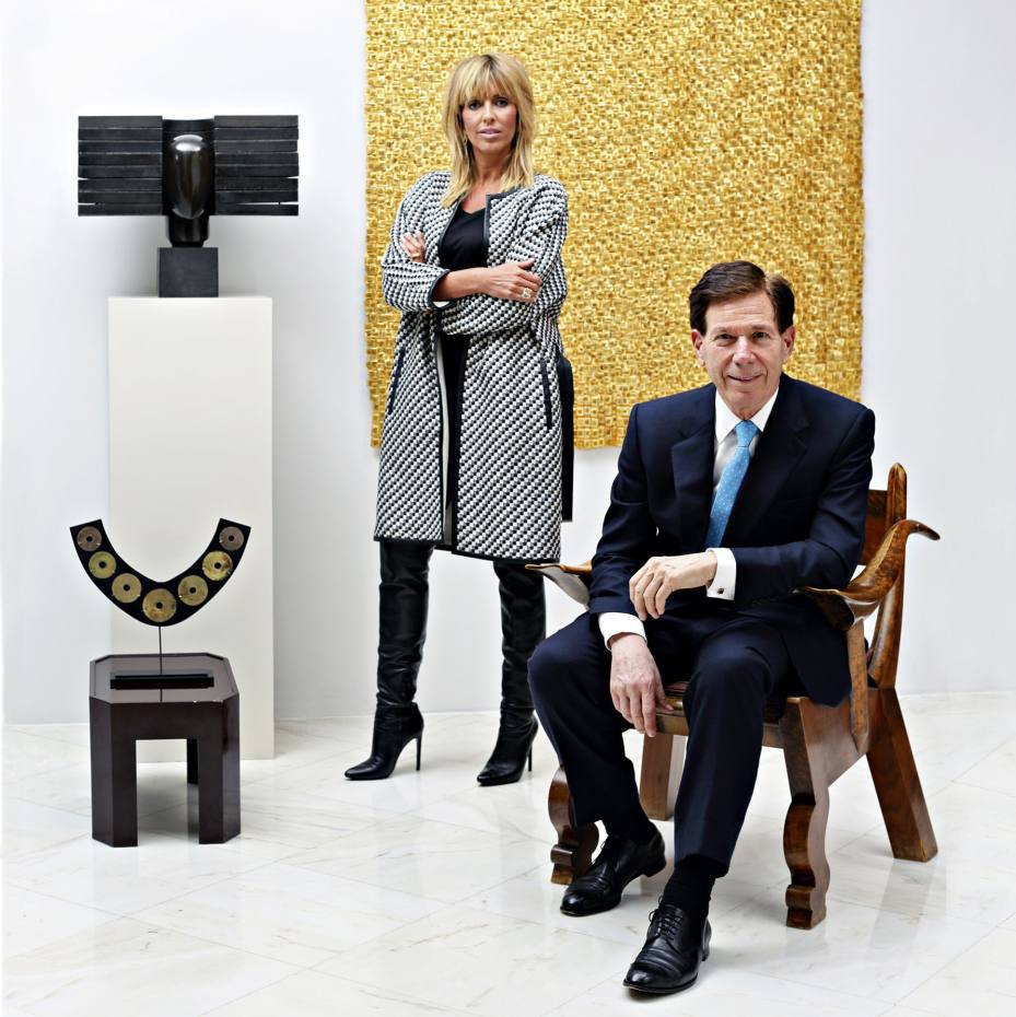 Gallerist Agnès Monplaisir and collector Peter Price in his Park Avenue apartment, with, clockwise from top left: Coloso III, 2002, by Manolo Valdés; (on wall) Montana 23, 2005, by Olga de Amaral; elm and walnut armchair, c1915, by Prazské Umelecké Dílny; pre-Columbian gold ear loops from the north of Ecuador