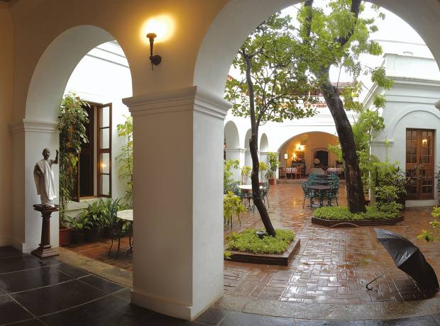 Entrance to the courtyard restaurant at Hotel de l'Orient in Puducherry