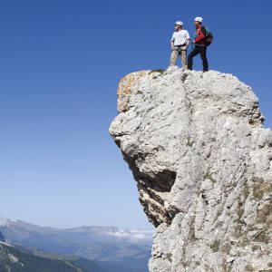 James Henderson and guide Albin on a peak with the Sassolungo Group behind.