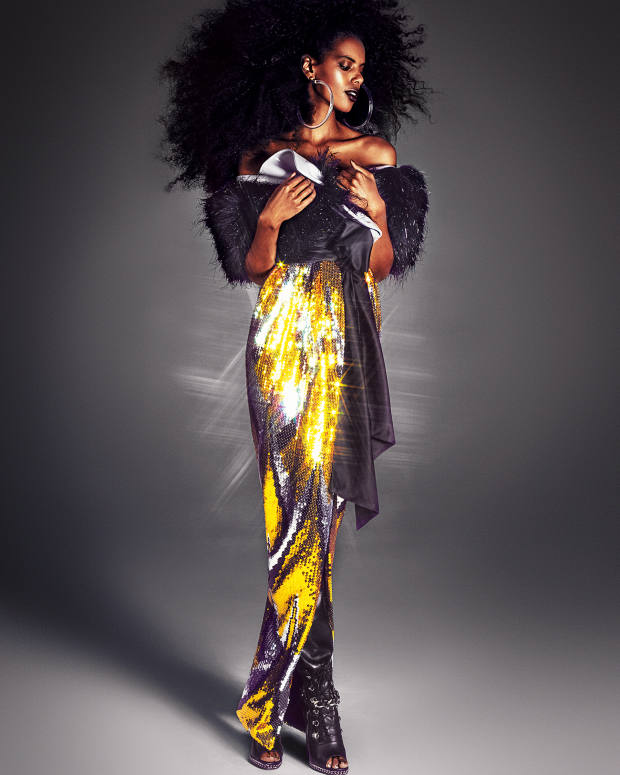 Marc Jacobs sequin and polyester-mix gown, about £3,463, and tinsel/vinyl shrug, price on request. Balmain leather boots, £2,113. Laruicci Lucite and gold-plated brass earrings, about £85