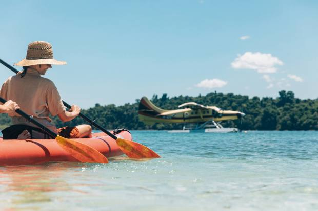 Kayaking in Coiba National Park as the Turbo Otter waits nearby