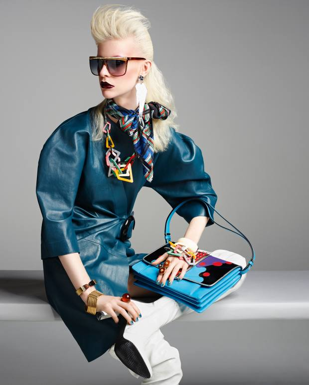 JW Anderson leather wrap dress, £1,350. Stuart Weitzman patent leather Fever boots, £430. Laura Biagiotti c1985 sunglasses, from £300, from The Eye Company. I Still Love You NYC Lucite earrings, £23. The Kooples silk scarf, £135. Tatty Devine Perspex Memphis necklace, £175, and matching bracelet (model's left arm bottom), £125. Paula Cademartori calfskin and crystal bag, £1,440. Chloé brass and quartz Gemma cuff (right arm top), £610. Lara Bohinc gold plated Galaxy bracelet (right arm bottom), £390. Fendi Plexiglas and metal ring (right hand), £264. Aurélie Bidermann gold plate and Bakelite Diana bangle (left arm top), £430. Tory Burch metal and semiprecious stone ring (left hand), £220