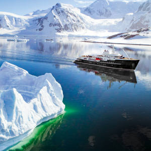 The 77m ice-breaking superyacht M/Y Legend navigating the huge icebergs of the Lemaire Channel in Antarctica