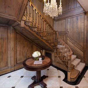 An 18th-century staircase in the entrance hall of a Grade I-listed townhouse on London's Queen Anne's Gate, £21m