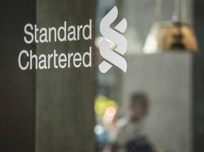 Standard Chartered guides down
