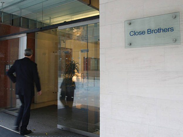Close Brothers maintains margin