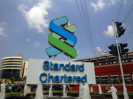 StanChart returns to dividend list