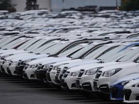 Auto Trader defies weak car market