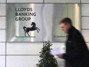 Lloyds suspends share buybacks