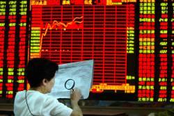 The Trader: Stocks start the week lower, earnings season ahead