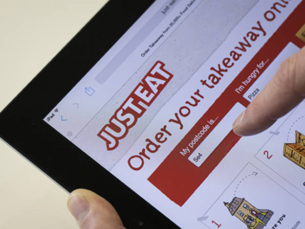 Just Eat plans merger as delivery push dents margins