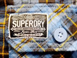 Superdry CEO buys in after losses widen