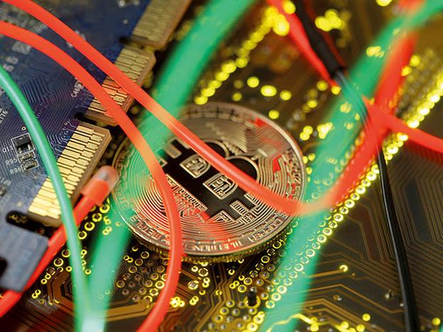 Bitcoin surges on Tesla filing