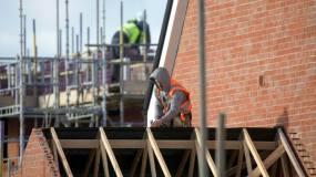 Article image: Taylor Wimpey raises profit target as housing market booms