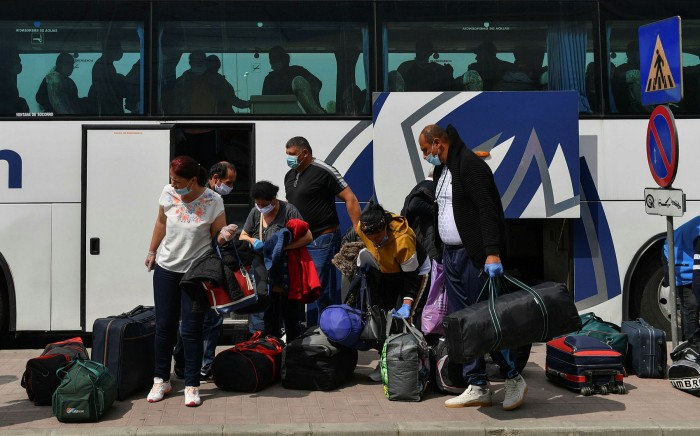 Romanian harvest workers heading to the UK en route in Bucharest last April