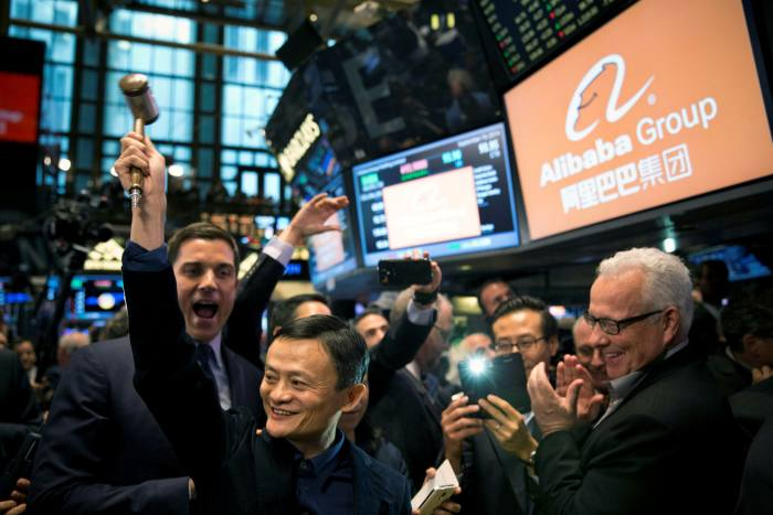 Jack Ma holds the gavel at the New York Stock Exchange in 2014. Mr Ma has not been seen in public since October last year