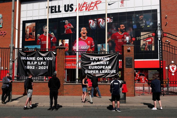 Fans outside Liverpool's Anfield ground condemn the planned Super League