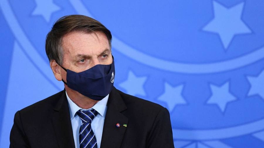 Bolsonaro is trying to promote aid as Brazil's Covid crisis worsens