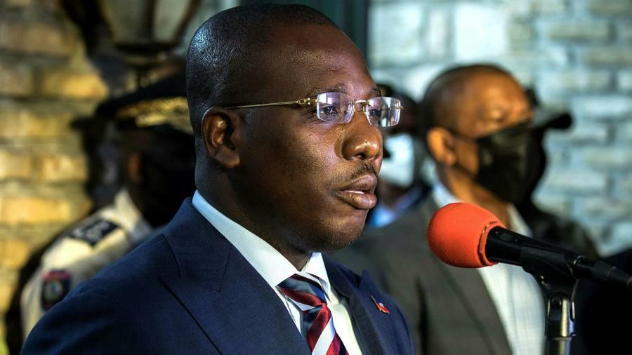 Haiti's interim prime minister agrees to step aside