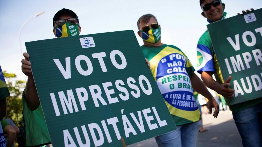 Brazil's Bolsonaro takes aim at election in echo of Trump