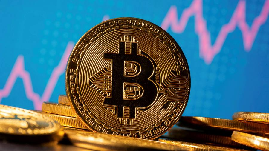 Record-setting bitcoin faces test after volatile week