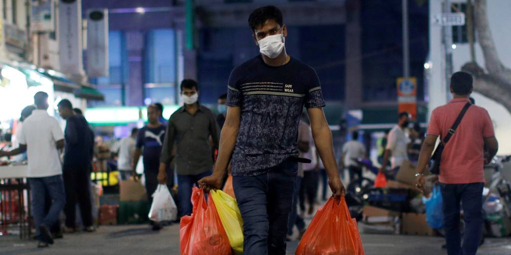 Singapore reports record new cases, quarantines migrant workers